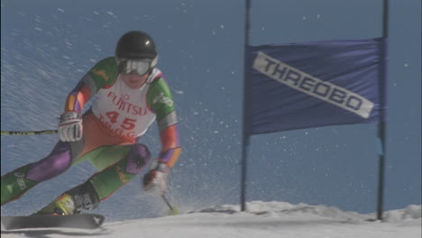 A-skier-moves-swiftly-down-hill-through-a-slalom-course