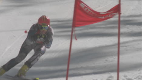 A-skier-skis-down-the-hill-hitting-the-flag-at-the-bottom