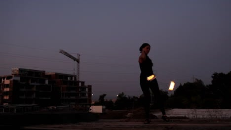 Woman-Dancing-with-Fire-00