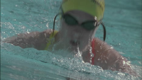 A-woman-swims-in-a-pool