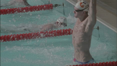 A-winner-stands-in-victory-after-swimming-to-the-finish-line
