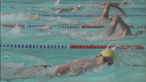 Competitive-swimmers-race-across-a-pool