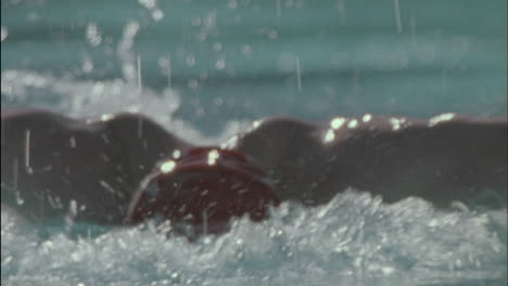 Swimmer-competes-in-butterfly-style-in-a-swimming-pool-1