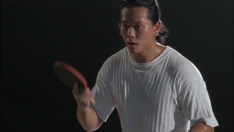 A-man-playing-pingpong-starts-to-sever-the-ball