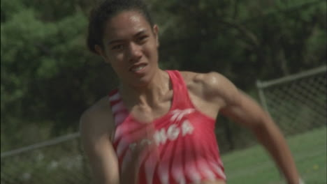 A-female-athlete-runs-from-a-starting-block-on-a-track