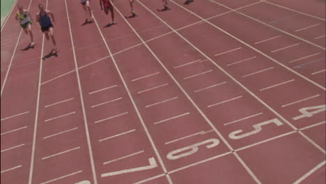 Runners-sprint-down-the-track-towards-the-finish-line