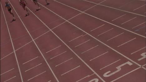 Five-women-run-a-race-on-a-racetrack