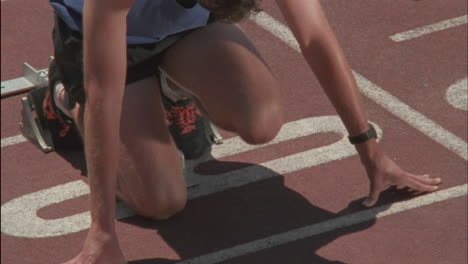 A-runner-kneels-at-the-starting-point-then-starts-to-race