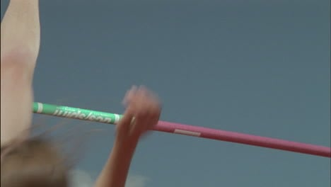 A-young-woman-high-jumps-over-a-pole
