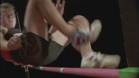 A-man-performs-a-high-jump-over-a-bar