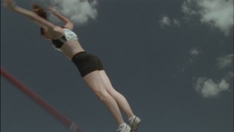 A-girl-performs-a-pole-vault-knocking-down-the-bar