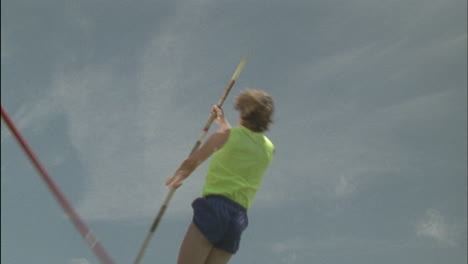 A-person-attempts-a-pole-vault-knocks-the-bar-down-and-falls