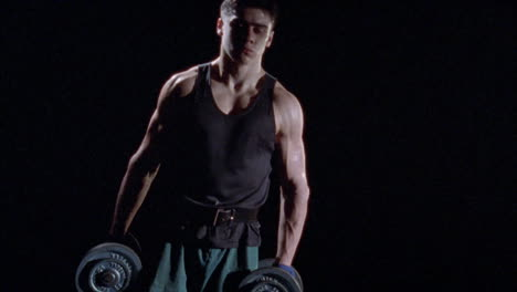 A-man-works-out-with-dumb-bells