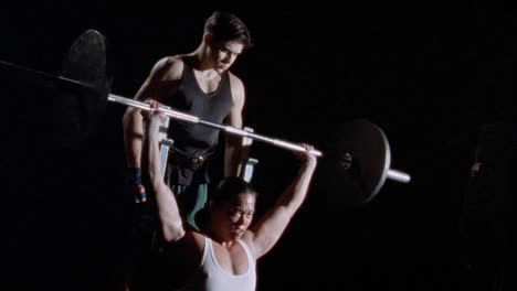 A-weight-lifter-gets-assistance-from-a-spotter