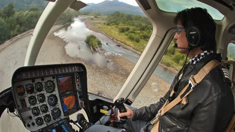 Pilot-taking-off-in-a-helicopter-from-the-Huequi-River-during-a-fly-fishing-trip-in-Southern-Chile