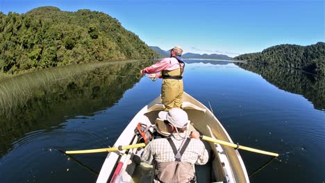 Two-men-on-a-flyfishing-adventure-on-Ceasar-Lake-in-Parque-Nacional-Corcovado-in-Southern-Chile-1