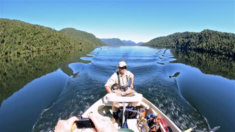 Guide-driving-a-boat-on-Ceasar-Lake-in-Parque-Nacional-Corcovado-during-the-flyfishing-trip-in-Southern-Chile
