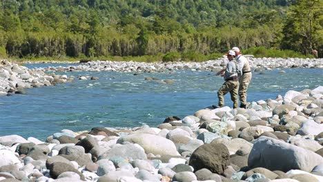 Guest-and-guide-casting-a-fly-fishing-rod-for-trout-on-the-Huequi-River-in-Southern-Chile