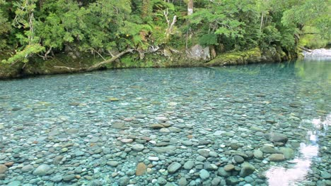Panning-the-clear-blue-waters-of-the-Huequi-River-in-Southern-Chile
