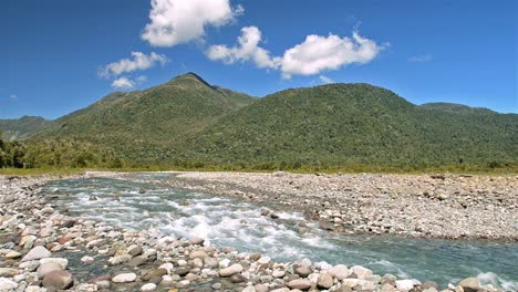 Mountains-clouds-and-the-clear-blue-waters-of-the-Huequi-Río-in-Southern-Chile