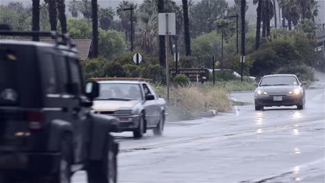 Cars-driving-on-a-wet-road-after-heavy-rain-in-Ventura-California
