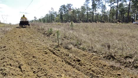 A-crew-member-grading-a-fire-break-with-an-ATV-through-Moody-Forest-Natural-Area-near-Baxley-Georgia