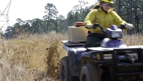 A-crew-member-grading-a-fire-break-with-an-ATV-through-Moody-Forest-Natural-Area-near-Baxley-Georgia-1