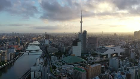 Aerial-of-the-Tokyo-Skytree-is-seen-at-sunset-nestled-in-the-skyline-of-Tokyo-Japan