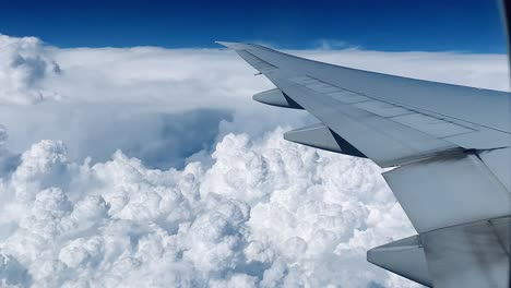 Point-of-view-shot-from-an-airplane-flying-high-above-tropical-thunderheads-and-clouds