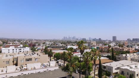 Rising-Aerial-From-Middle-Class-Area-Near-Hollywood-California-With-Downtown-Los-Angeles-In-Distance
