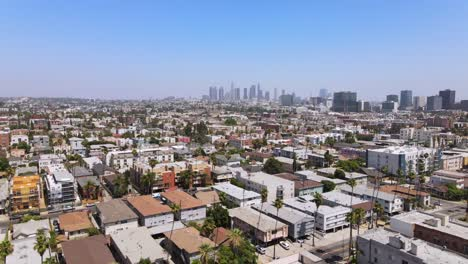 Rising-Aerial-From-Middle-Class-Area-Near-Hollywood-California-With-Downtown-Los-Angeles-In-Distance-1