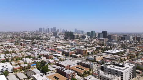 Rising-Aerial-From-Middle-Class-Area-Near-Hollywood-California-With-Downtown-Los-Angeles-In-Distance-2