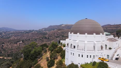 Aerial-Past-The-Griffith-Park-Observatory-Reveals-Hollywood-Sign-In-Distance-Los-Angeles-California