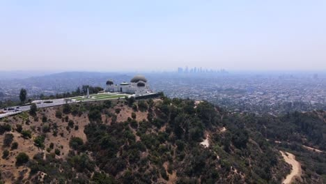 Good-Rising-Aerial-Of-The-Griffith-Park-Observatory-With-Downtown-Los-Angeles-Distant