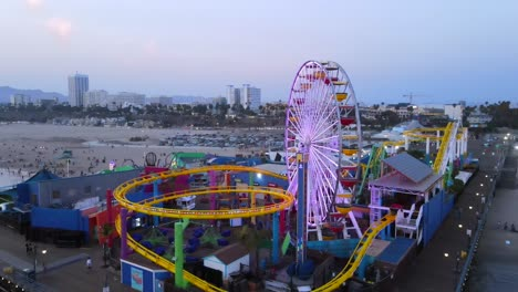 Aerial-Of-The-Santa-Monica-Pier-And-Ferris-Wheel-At-Night-Or-Dusk-Light-Los-Angeles-California-1