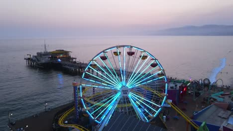 Aerial-Of-The-Santa-Monica-Pier-And-Ferris-Wheel-At-Night-Or-Dusk-Light-Los-Angeles-California-2