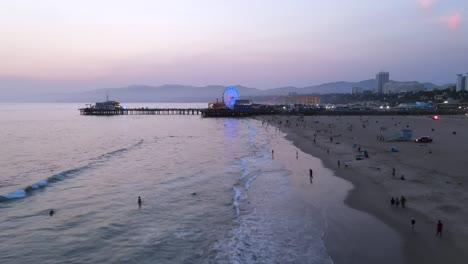 Vista-Aérea-Of-The-Santa-Monica-Pier-And-Ferris-Wheel-At-Night-Or-Dusk-Luz-Los-Angeles-California-3