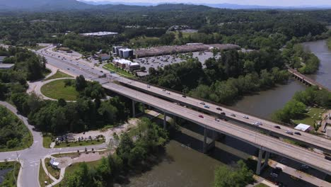 Aerial-Over-Highway-Bridge-Over-The-French-Broad-River-In-Asheville-North-Carolina-1