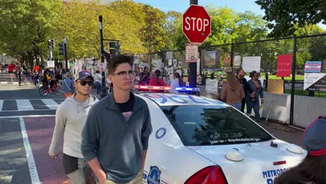 A-Police-Car-Is-Parked-Next-To-A-Black-Lives-Matter-Display-In-Washington-Dc