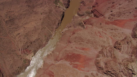 Slow-Aerial-Shot-Looking-Straight-Down-At-The-Colorado-River-In-The-Grand-Canyon