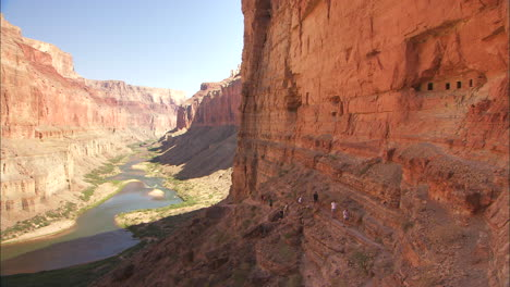Hikers-On-A-Narrow-Trail-Along-A-Cliff-In-The-Grand-Canyon
