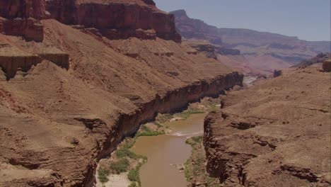 Remarkable-Aerial-From-Rim-Of-Grand-Canyon-To-White-Water-Raft-On-River