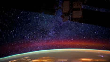 The-International-Space-Station-Flies-Over-The-Aurora-Borealis