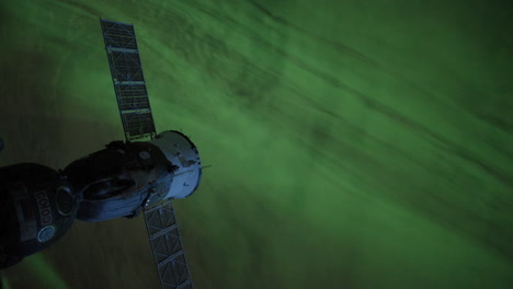The-International-Space-Station-Flies-Over-The-Aurora-Borealis-1