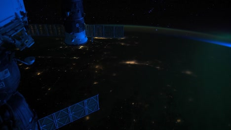 The-International-Space-Station-Flies-Over-The-Aurora-Borealis-3