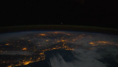 The-International-Space-Station-Flies-Over-The-Earth-At-Night