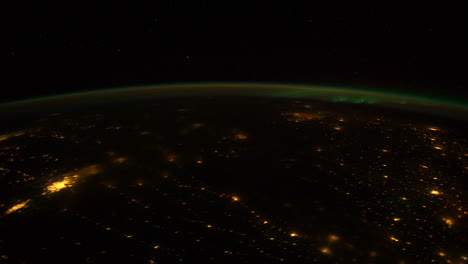 The-International-Espacio-Station-Flies-Over-The-Earth-At-Night-1