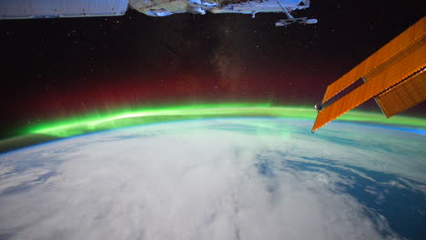 The-International-Space-Station-Flies-Over-The-Earth-With-Aurora-Borealis-Visible