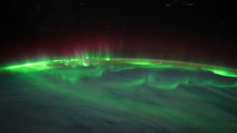 The-International-Space-Station-Flies-Over-The-Earth-With-Aurora-Borealis-Visible-1
