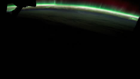 The-International-Space-Station-Flies-Over-The-Earth-With-Aurora-Borealis-Visible-2